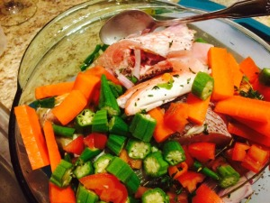Allow seasoned fish to marinate with veggies for 15 minutes