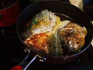 Brown fish on each side in Oil and Butter