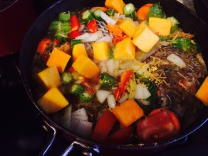 Combine veggies with browned fish and water. Allow to simmer